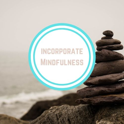 "Thyroid resources with the words ""Incorporate Mindfulness"" Against a view of the beach with rocks piled 
