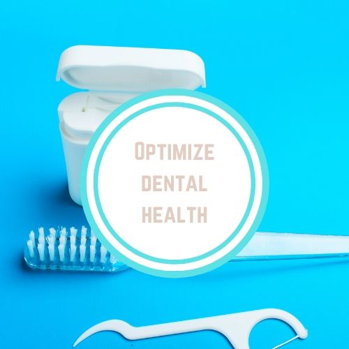 "Thyroid Resources with the Words ""Optimize Dental Health"" on top of a photo of dental floss and a toothbrush 